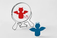Angel looking in the mirror and seeing himself as a devil - Good and evil, distorted self-image concept. Angel looking in the mirror and seeing himself as a stock images
