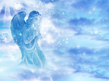 Angel love. A statue of praying angel over starry sky with copy space Stock Photos