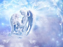 Angel love. Two embracing angels with magic background stock photos