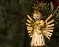An angel made of straw hanging on a christmas tree Stock Photography