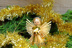 Angel made of straw with a star on his forehead Royalty Free Stock Photography