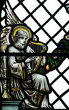 Angel making music (harp) in stained glass. A photo of an Angel making music (harp) in stained glass stock photography
