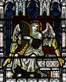 Angel making music ( playing harp)in stained glass Royalty Free Stock Photo