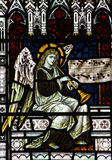 Angel making music (playing trumpet) in stained glass. A photo of a an Angel making music in stained glass royalty free stock images