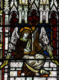 Angel making music in stained glass. A photo of a an Angel making music in stained glass royalty free stock images