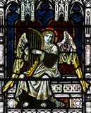 Angel making music in stained glass Stock Photography