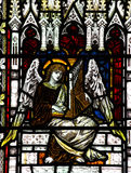 Angel making music in stained glass. A photo of an Angel making music in stained glass stock photos