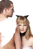 Angel man and devil girl. Over white royalty free stock photos