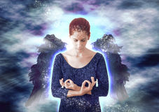 Angel meditating Royalty Free Stock Image