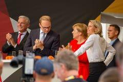 Angel Merkel in election battle 2017 in Heidelberg. Angela Merkel has been plastered with tomatos royalty free stock photo