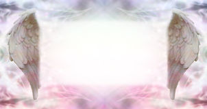 Angel Message Board. Wide ethereal energy background flanked by two Angel wings with a large misty white message board area Stock Photo
