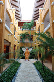 Angel on a Mexico Resort Building. Barcelo Maya Colonial Resort, Riviera Maya Royalty Free Stock Photography