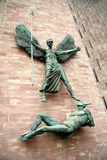 Angel Michael versus Lucifer. Angel Michael banishes Lucifer from heaven to hell in a triumph of good versus evil. The new Coventry Cathedral (England Stock Image