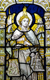 Angel Michael weighing the souls in stained glass. A photo of Angel Michael weighing the souls in stained glass royalty free stock photo
