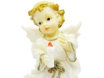 Angel miniature holding a candle Royalty Free Stock Photo