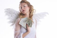 Angel with money Royalty Free Stock Photo