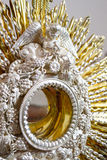 Angel in monstrance close up. Vertical image in color of a metallic monstrance in close up with shallow depth of field Stock Image