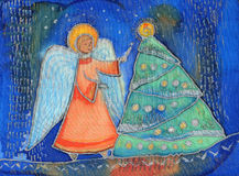 Angel near by the Christmas tree. Royalty Free Stock Image