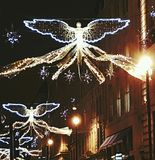 Angel neon city light england europa public building christmas decoration xmas december. Neon angel illuminated christmas decoration xmas december london britain Stock Photo