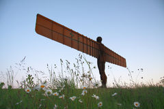 Angel of the North and Flowers. Antony Gormley's Angel of the North commissioned by Gateshead Council, and funded by the National Lottery. England, United Royalty Free Stock Image