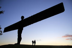 Angel of the North and Lovers. Antony Gormley's Angel of the North commissioned by Gateshead Council, and funded by the National Lottery. England, United Kingdom Royalty Free Stock Photography