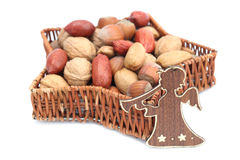 Angel and nuts Stock Photography