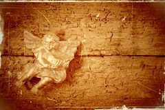 Angel in old wooden background Stock Photos