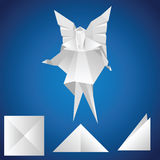 Angel. Origami. Origami. A paper angel on a blue background Stock Photos