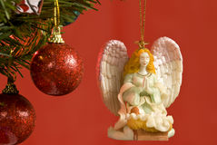 Angel Ornament Hanging On Christmas Tree Stock Images