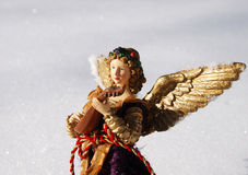 Angel ornament in snow Stock Photos