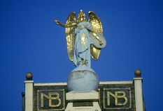 Angel ornamentation on rooftop in Amsterdam, Holland Royalty Free Stock Image