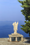 Angel over the sea, Croatia. PRIMOSTEN, CROATIA - SEPTEMBER 10, 2016: This is the figure of the Angel, facing the sea, at the highest point of the old city stock photography