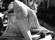 Angel in pain. Tomb statue in a cemetery in Rome Stock Image