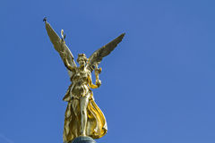 Angel of Peace,. The Angel of Peace, a memorial in Munich is golden and six meters high and is located on a column in Corinthian style Royalty Free Stock Image