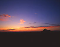 Angel Peak. A desert formation silhouetted by sunset in New Mexico Stock Photography