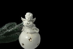 Angel with a pigeon on a white Christmas sphere. Royalty Free Stock Images