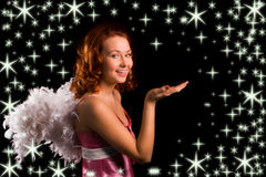 Angel in pink. On black background with starlet Royalty Free Stock Images