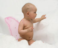 The angel with pink wings (cloud imitation). The Image of the child on a white background Royalty Free Stock Photo
