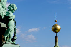 Angel and pinnacle. Berlin cathedral angel and golden sphere pinnacle Royalty Free Stock Photography