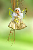 Angel play. Cute angel with her guitar in a pine tree Stock Images