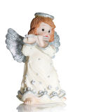 Angel playing on a flute Stock Photo