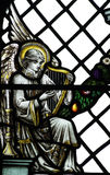 An angel playing on a harp (making music) in stained glass Royalty Free Stock Photo
