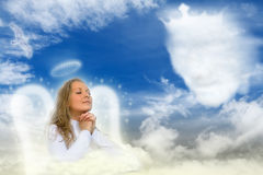 An Angel Praying. Lovely angel praying to God Stock Photos