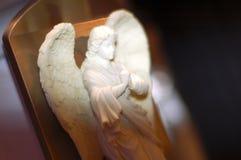 Angel praying. Close up shot of angel statue figure praying Stock Photos
