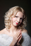 Angel praying. Studio portrait of beautiful young blond female model angel with curly hair, hazel eyes, wearing tender light makeup with red lips, top with Royalty Free Stock Photos
