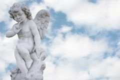 Angel with pretty sky. Angel with pretty cloudy sky stock images