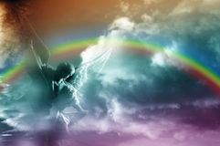 Angel and rainbow Stock Photos