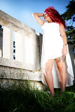 Angel red hair styled teen. Red hair italian girl with long red curly hair / Wide angle from below / angelic white dress Royalty Free Stock Image