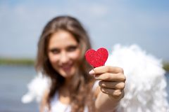 Angel with red heart outdoors Stock Photography