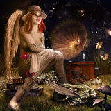 Angel with red rose. Fairytale night scenery with angel, dragon baby, butterflies and gramophone Stock Photography